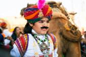 Child with fake mustache on the carnaval of Desert Festival — Stock Photo