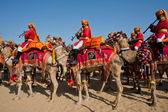 Camel caravan with musicians of the Desert Festival — Stock Photo