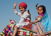 Happy children have fun in traditional dresses during carnival — Stock Photo