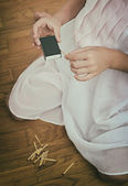 Girl playing with matches. Dangerous situation at home. — Stock Photo