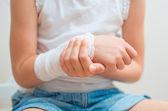 Child arm with gauze bandage on it. — Stock Photo
