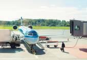 Passenger plane maintenance in airport before flight. — Stock Photo