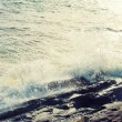 Big windy waves splashing over rocks. Storm begins. — Stock Photo #56212389