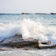Big windy waves splashing over rocks. Storm begins. — Stock Photo #56212487