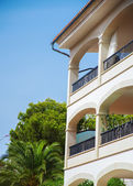 Portrait of tropical apartment building with palms. — Stock Photo