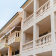 Portrait of tropical apartment building with balconies. — Stock Photo #58148911