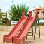 Modern children playground slide in city park. — Stock Photo #58148947
