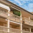 Portrait of tropical apartment building with balconies. — Stock Photo #58148979