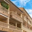 Portrait of tropical apartment building with balconies. — Stock Photo #58148981