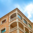 Portrait of tropical apartment building with balconies. — Stock Photo #58283411