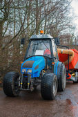 Blue tractor on the street. — Stock Photo