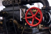 Red valve. Part of old power plant. — Stock Photo