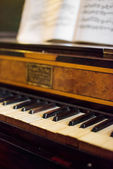 Vintage photo of old piano with notes. — Stock Photo