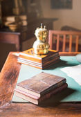 Old books lying on the dusty table. — Stockfoto