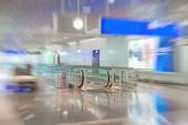 Airport interior with escalator. Motion blur. — Stock Photo