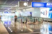 Airport interior with escalator. Motion blur. — Stock Photo