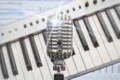 Retro microphone over piano and recording software background. — Stock Photo
