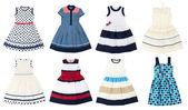 Vestidos das meninas isolado no fundo branco. Colagem de 8 fotos. — Fotografia Stock