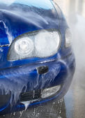 Blue car wash using high pressure water jet. — Stok fotoğraf