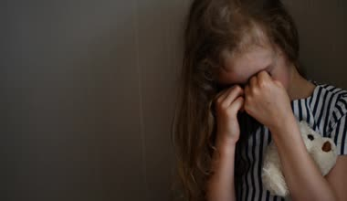 Little girl crying in the corner. Domestic violence concept. — Stock Video