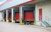 Warehouse with four red sliding gates. — Stock Photo