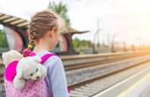 Little girl waiting for train at the railway station. — Stock Photo