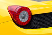 Close-up view of yellow sports car rear light. — Stock Photo