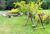 Swing and furniture in the garden. — Stock Photo
