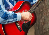 Man playing guitar on the street. Unrecognizable person. — Stock Photo
