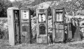 Black and White image of old rusting gas pumps found in an antiq — Stock Photo