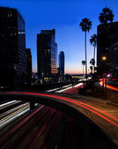 Night view of Los Angeles freeway and buildings — Stock Photo