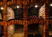 Wine cellar with many kinds of bottles — Stock Photo