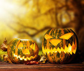 Scary hallowen pumpkin on wood — Stock Photo