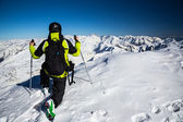Adventurer on the top of alpine mountains — Foto Stock