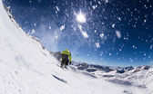 Alpine skier on piste, skiing downhill — Foto Stock