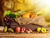 Autumn fruit and vegetable in wooden box — Stock Photo