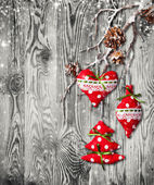 Hand made traditional christmas decoration on wood — Stock Photo