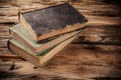 Old books on wooden table — Stock Photo