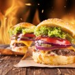 Home-made hamburgers with fire — Stock Photo #54762591