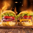 Home-made hamburgers with fire — Stock Photo #54762625