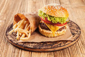 Fresh hamburger on wooden planks — Stock Photo