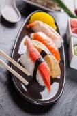 Delicious sushi pieces served on black stone — ストック写真