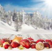 Winter scenery with christmas balls — Stock Photo
