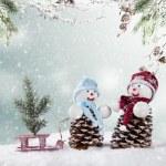 Winter snowy scenery with snow men — Stock Photo #58786495