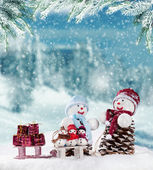 Winter snowy scenery with snow men — Stock Photo