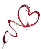 Red wine splash heart on white background — Stock Photo