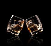 Glasses of whiskey on black background — Stock Photo