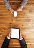 Man and woman working on mobile devices — Stock Photo