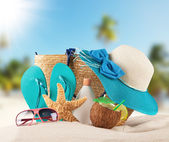 Summer beach with blue sandals and shells — Stock Photo