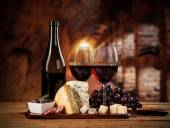 Various kind of cheese with wine — Stock Photo